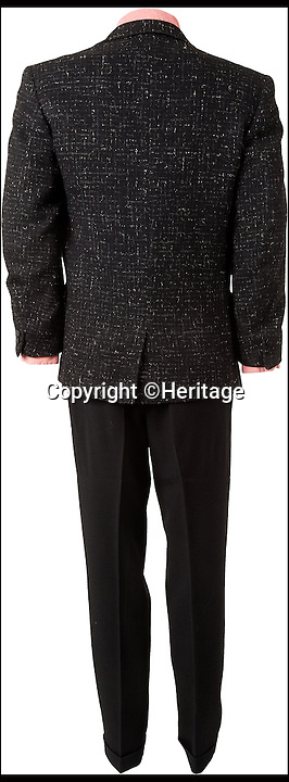 BNPS.co.uk (01202 558833)<br /> Pic: Heritage/BNPS<br /> <br /> ***Please Use Full Byline***<br /> <br /> The back view of Elvis' suit, with sports jacket.<br /> <br /> The outfit Elvis Presley was wearing when he signed the momentous recording contract that rocketed him to international stardom has emerged for sale for 24,000 pounds.<br /> <br /> Despite being just 20 when he put pen to paper, Elvis was already the hottest thing in country music and was snapped up by record label giant RCA for a whopping 40,000 dollars - the equivalent of almost 400,000 dollars or 237,000 pounds today.