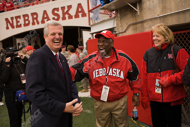 Supreme Court Justice Clarence Thomas (center) and his wife talk on the sidelines with a University of Nebraska official before The University of Nebraska vs. The University of Southern California football game. Lincoln, Nebraska, September 15, 2007.