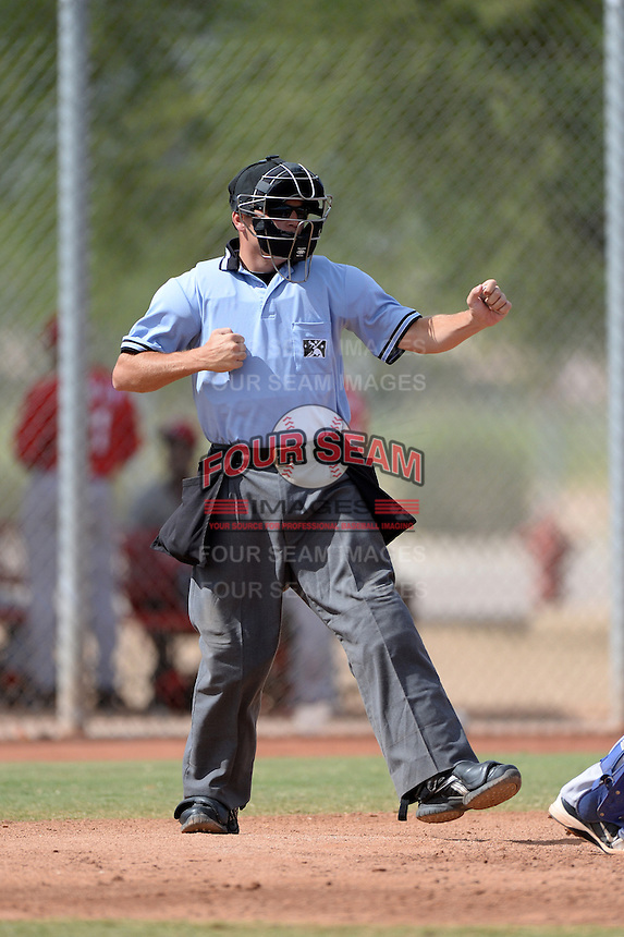 Umpire Jansen Visconti makes a call during an Instructional League game between the Texas Rangers and Cincinnati Reds on October 7, 2013 at Goodyear Training Complex in Goodyear, Arizona.  (Mike Janes/Four Seam Images)