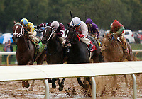 """LEXINGTON, KY - October 8, 2017. #12 Flameaway and Julien Leparoux (outside, gold/blue cap) win the 27th running of the Dixiana Bourbon Grade 3 $250,000 """"Win and You're In Breeders' Cup Juvenile Turf Division"""" for owner John Oxley and trainer Mark Casse at Keeneland Race Course.  Lexington, Kentucky. (Photo by Candice Chavez/Eclipse Sportswire/Getty Images)"""