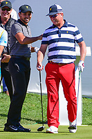 Jason Day (AUS) and Charley Hoffman (USA) share a laugh with the crowd on the first tee during round 4 Singles of the 2017 President's Cup, Liberty National Golf Club, Jersey City, New Jersey, USA. 10/1/2017. <br /> Picture: Golffile | Ken Murray<br /> <br /> All photo usage must carry mandatory copyright credit (&copy; Golffile | Ken Murray)