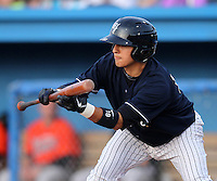 Empire State Yankees shortstop Ramiro Pena #19 attempts a bunt during a game against the Norfolk Tides in the first ever Triple-A contest to be held at Dwyer Stadium on April 20, 2012 in Batavia, New York.  (Mike Janes/Four Seam Images)