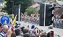Grand Depart - Tour de France 2014<br /> Yorkshire England.<br /> Leaders go through famous town of Ilkley with Moors in distance.<br /> <br /> Peleton arrives<br /> <br /> Pic by Gavin Rodgers/Pixel 8000 Ltd