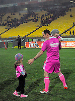Referee Cameron Stone greets his kids after the ITM Cup rugby union match between Wellington Lions and Northland at Westpac Stadium, Wellington, New Zealand on Saturday, 29 August 2015. Photo: Dave Lintott / lintottphoto.co.nz