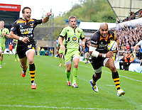 High Wycombe, England. Tom Varndell of Wasps runs in for a try during the Aviva Premiership match between Wasps and Northampton Saints at Adams Park on September 14, 2014 in High Wycombe, England.