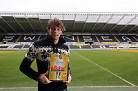 Pictured: Michu with the Mat ch of the Day magazine award. Thursday 28 February 2013<br />