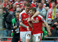 Sam Winnall (9) of Barnsley celebrates with Alfie Mawson after scoring the equaliser with a header past goalkeeper Benjamin Buchel of Oxford United during the Johnstone's Paint Trophy Final match between Oxford United and Barnsley at Wembley Stadium, London, England on 3 April 2016. Photo by Alan  Stanford / PRiME Media Images.
