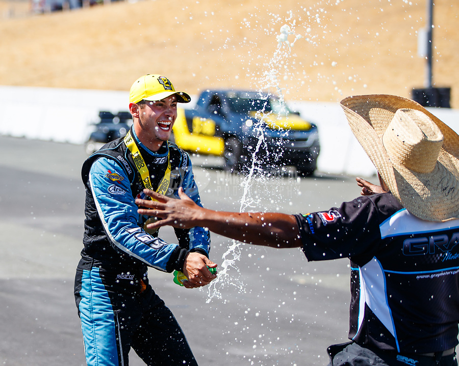 Jul 30, 2017; Sonoma, CA, USA; NHRA pro stock driver Tanner Gray celebrates with crew member after winning the Sonoma Nationals at Sonoma Raceway. Mandatory Credit: Mark J. Rebilas-USA TODAY Sports