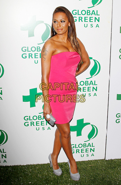 MELANIE BROWN - MEL B.The 7th Annual Global Green Pre-Oscar Party held at Avalon in Hollywood, California, USA. .March 3rd, 2010 .full length dress pink neon fluorescent strapless mini grey gray patent platform shoes heels scary spice tattoo hand on hip .CAP/JE.©James Eden/Capital Pictures.