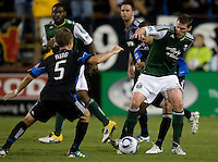Kenny Cooper of Timbers controls the ball away from Earthquakes defenders during the game at Buck Shaw Stadium in Santa Clara, California on August 6th, 2011.   San Jose Earthquakes and Portland Timbers tied 1-1.