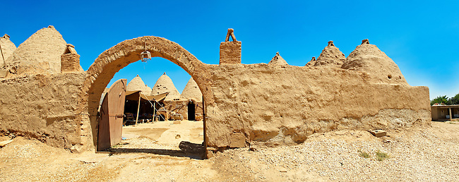"""Pictures of the beehive adobe buildings of Harran, south west Anatolia, Turkey.  Harran was a major ancient city in Upper Mesopotamia whose site is near the modern village of Altınbaşak, Turkey, 24 miles (44 kilometers) southeast of Şanlıurfa. The location is in a district of Şanlıurfa Province that is also named """"Harran"""". Harran is famous for its traditional 'beehive' adobe houses, constructed entirely without wood. The design of these makes them cool inside. 38"""