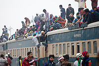 Muslim devotees try to catch an over-crowded train as they return home after a three-day World Congregation of Muslims, or Biswa Ijtema, on the banks of the River Turag just outside Dhaka, Bangladesh. Jan 11, 2015