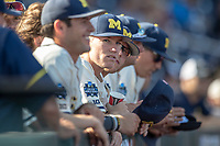 Michigan Wolverines pitcher Walker Cleveland (35) in the dugout before taking on the Vanderbilt Commodores in Game 1 of the NCAA College World Series Finals on June 24, 2019 at TD Ameritrade Park in Omaha, Nebraska. Michigan defeated Vanderbilt 7-4. (Andrew Woolley/Four Seam Images)