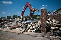 Wrecking crews remove a large portion of Westerville Square Shopping Center to make way for the construction of a new WalMart store in the Columbus suburb. The store will approximately 108,000-square-feet, about half the  size of a traditional WalMart super store.