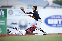 West Virginia Black Bears second baseman Tristan Gray (2) waits for a throw as Thomas Jones (49) dives back into the bag during a game against the Batavia Muckdogs on June 26, 2017 at Dwyer Stadium in Batavia, New York.  Batavia defeated West Virginia 1-0 in ten innings.  (Mike Janes/Four Seam Images)