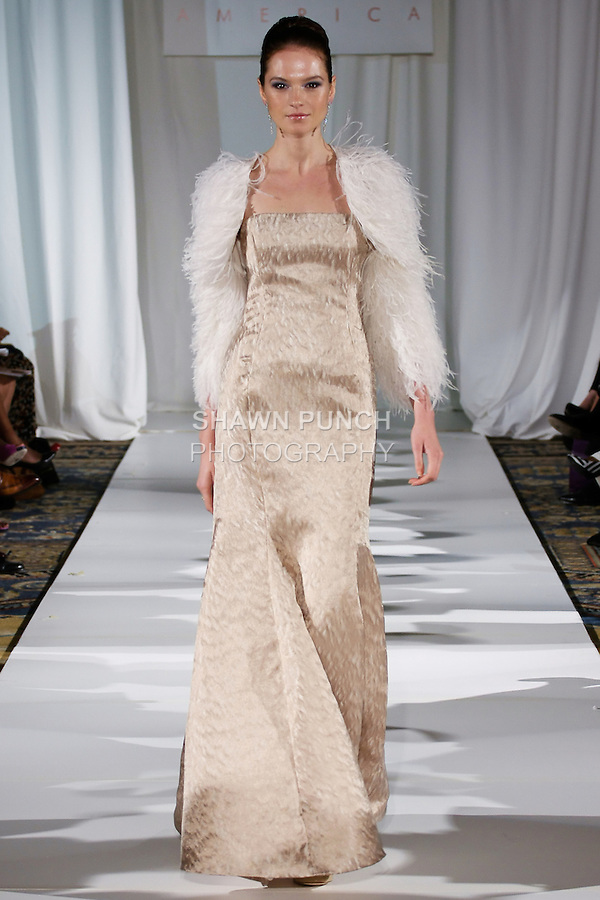 Tania walks runway in a white hand embroidered beaded ostrich, demi jacket worn over a champagne silk-faced wool signature mermaid gown, from the b Michael AMERICA Couture Spring 2013 collection during Mercedes-Benz Fashion Week Spring 2013, at the Jumeirah Essex House on September 12, 2012.