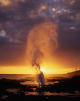 Spouting Horn Blowhole, Backlit by Sunset, Kauai, Hawaii, USA.