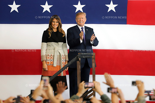 November 5, 2017, Tokyo, Japan - U.S. President Donald Trump, accompanied by his wife Melania (L) reacts to U.S. soldiers as he delivers a speech before them at the Yokota Air Base in Tokyo on Sunday, November 5, 2017. Trump arrived here on a three0day official visit to Japan for the first leg of his Asian tour.    (Photo by Yoshio Tsunoda/AFLO) LWX -ytd-
