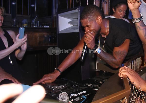 HOLLYWOOD, CA - JUNE 29, 2014<br /> Usher attends Usher's BET awards after party at Emerson, June 29, 2014 in Hollywood, CA<br /> Walik Goshorn/MediaPunch