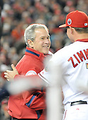 Washington, D.C. - March 29, 2008 -- United States President George W. Bush is greeted by Washington Nationals third baseman Ryan Zimmerman (11) prior to throwing out the first pitch as the Atlanta Braves visit Nationals Park in Washington, D.C. on Sunday, March 30, 2008..Credit: Ron Sachs / CNP.(RESTRICTION: NO New York or New Jersey Newspapers or newspapers within a 75 mile radius of New York City)