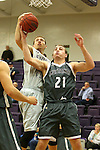 SIOUX FALLS, SD - DECEMBER 8:  Jordan Stotts #44 from the University of Sioux Falls battles for the ball with Turner Moen #21 from Southwest Minnesota State Tuesday night at the Stewart Center. (Photo by Dave Eggen/Inertia)