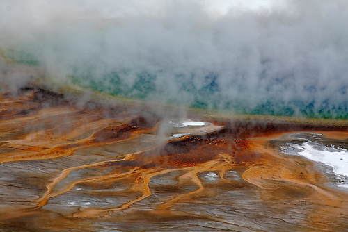 The Grand Prismatic hot spring shows its colors during the winter at Yellowstone National Park