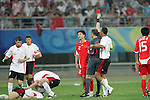 10 August 2008: Referee Hector Baldassi (ARG) shows a red card to Tan Wangsong (CHN) (2).  The men's Olympic soccer team of Belgium defeated the men's Olympic soccer team of China 2-0 at Shenyang Olympic Sports Center Wulihe Stadium in Shenyang, China in a Group C round-robin match in the Men's Olympic Football competition.