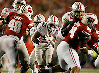 Ohio State Buckeyes running back Mike Weber (25) rushes up the middle toward Wisconsin Badgers linebacker Jack Cichy (48) during the third quarter of the NCAA football game at Camp Randall Stadium in Madison, Wisconsin on Oct. 15, 2016. Ohio State won 30-23. (Adam Cairns / The Columbus Dispatch)