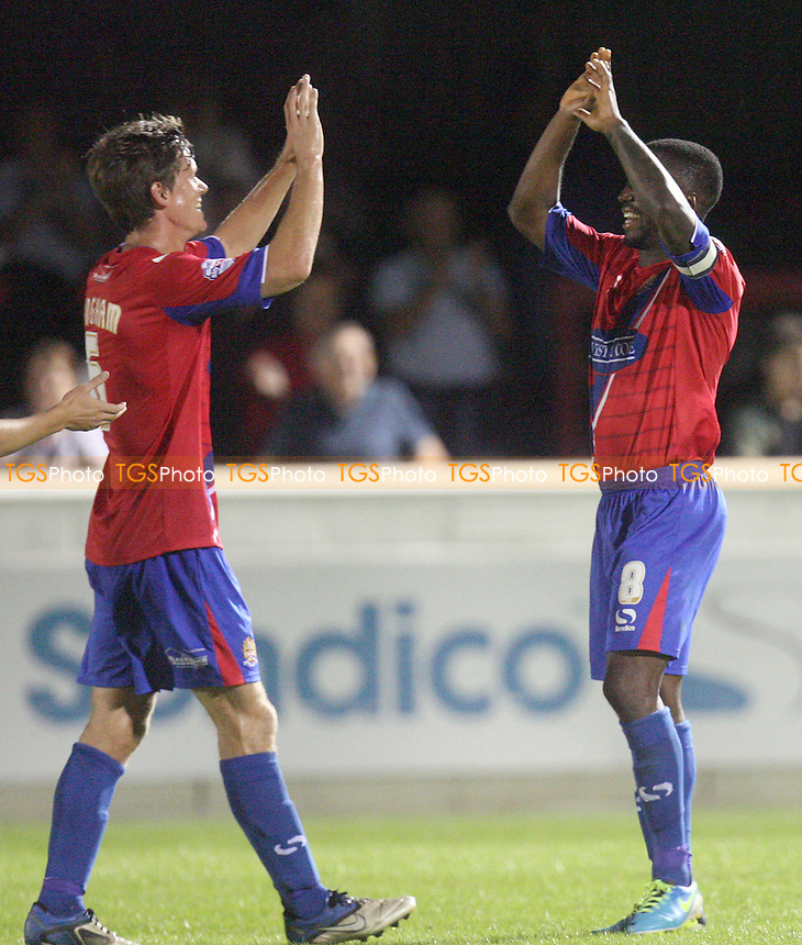 Abu Ogogo of Dagenham and Redbridge is congratulated after scoring the third Daggers goal - Dagenham and Redbridge vs Colchester United at the London Borough of Barking and Dagenham Stadium - 03/09/13 - MANDATORY CREDIT: Dave Simpson/TGSPHOTO - Self billing applies where appropriate - 0845 094 6026 - contact@tgsphoto.co.uk - NO UNPAID USE