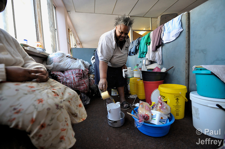 More than 3,000 refugees from Zimbabwe and other African countries are crowded into the Central Methodist Church in Johannesburg, South Africa, where this woman cooks in her makeshift kitchen. The refugees suffer from economic desperation and sporadic xenophobic attacks.