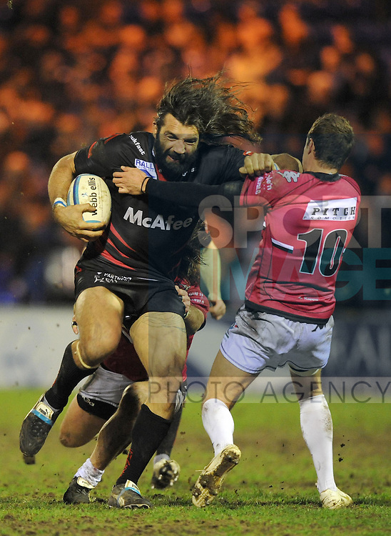 Sale Shark's Sebastien Chabal charges through Maxime Petitjean of Brive