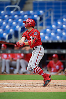 Washington Nationals Carter Kieboom (9) follows through on a swing during a Florida Instructional League game against the Miami Marlins on September 26, 2018 at the Marlins Park in Miami, Florida.  (Mike Janes/Four Seam Images)