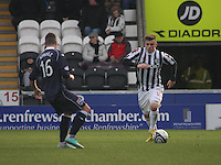 Graham Carey runs at Ivan Sproule in the St Mirren v Ross County Clydesdale Bank Scottish Premier League match played at St Mirren Park, Paisley on 19.1.13.
