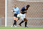 25 September 2011: North Carolina's Adelaide Gay (33) watches her attempted clearance ricochet off of the backside of Virginia's Gloria Douglas (right). The University of Virginia Cavaliers defeated the University of North Carolina Tar Heels 1-0 in overtime at Fetzer Field in Chapel Hill, North Carolina in an NCAA Division I Women's Soccer game.