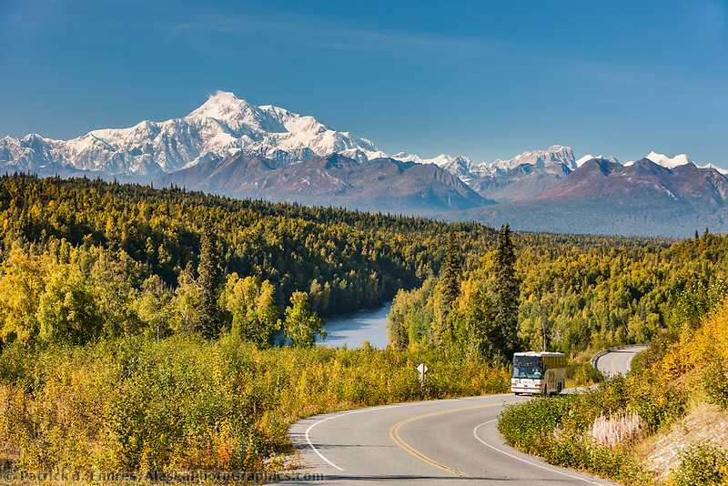 Bus on spur road of the Parks Highway and South view of Mt. Denali, North America's highest peak.