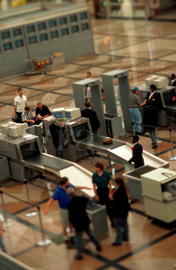 Overview of airline travelers clearing security at Denver International Airport.