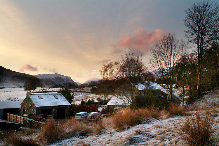 Sunrise over a small row of cottages and a farm. Near Ullswater, Lake District, Cumbria.