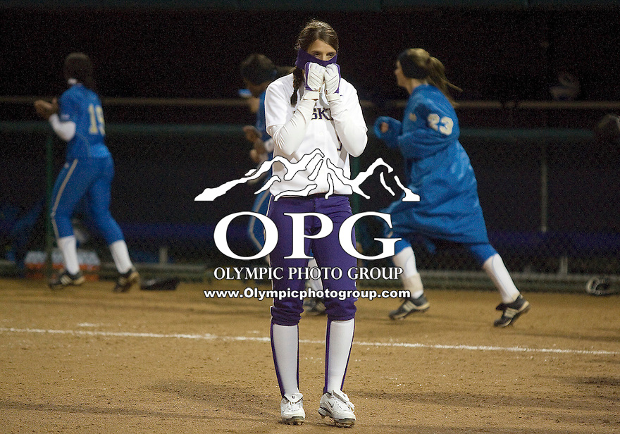 1 April 2010:  Washington Huskies second baseman #5 Amanda Fleischman walks off the field covering her face after losing to UCLA. UCLA defeated Washington 1-0 at Husky Softball Stadium in Seattle, WA.