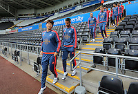 (L-R) Ki Sung Yueng and Kyle Naughton of Swansea  lead team mates down the stand prior to the Barclays Premier League match between Swansea City and Arsenal at the Liberty Stadium, Swansea on October 31st 2015
