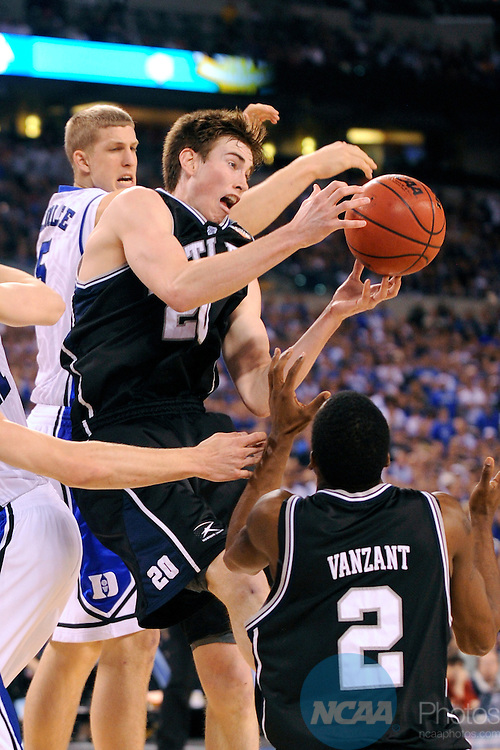 5 APR 2010: Gordon Hayward (20) of Butler University pulls down a rebound in front of Mason Plumlee (5) from Duke during the championship game of the Men's Final Four Basketball Championship held at Lucas Oil Stadium in Indianapolis, IN. Duke went on to defeat Butler 61-59 to claim the championship title. Ryan McKee/NCAA Photos