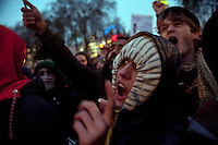 A protestor shouts during a student demonstration in Westminster, central London on the day the government passed a bill to increase university tuition fees.