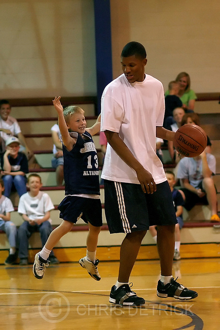 Altamont, UT --6/18/08--.Utah Jazz rookie Morris Almond plays 1 on 1 basketball with Lane Benson, 8, in Altamont Wednesday, June 18, 2008..*************************.The Jazz will be holding their first session of Jr. Jazz camps June 18-21 in eastern Utah. Morris Almond is going to be the player making the rounds. They will be spending the night that Wednesday in Vernal, that Thursday in Price and that Friday in Moab. Ross will go on the road Wednesday, stay in Vernal, make the stops Thursday on the way to Price and then come home that night. It's got to be some of the most remote ground any NBA player will cover this season...Photo by Chris Detrick/The Salt Lake Tribune.frame #_2CD3183a.