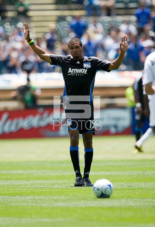 June 20, 2009:  Ryan Johnson of Earthquakes waves his arms up to obey the referee during a game at Coliseum in Oakland, California. San Jose Earthquakes defeated Los Angeles, 2-1.