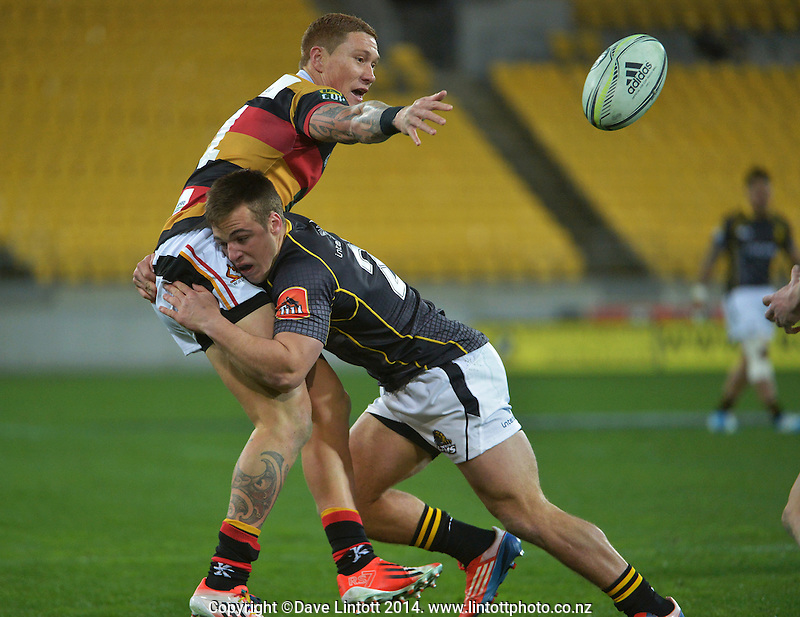 Wes Goosen tackles Declan O'Donnell during the ITM Cup rugby union match between Wellington Lions and Waikato at Westpac Stadium, Wellington, New Zealand on Saturday, 16 August 2014. Photo: Dave Lintott / lintottphoto.co.nz