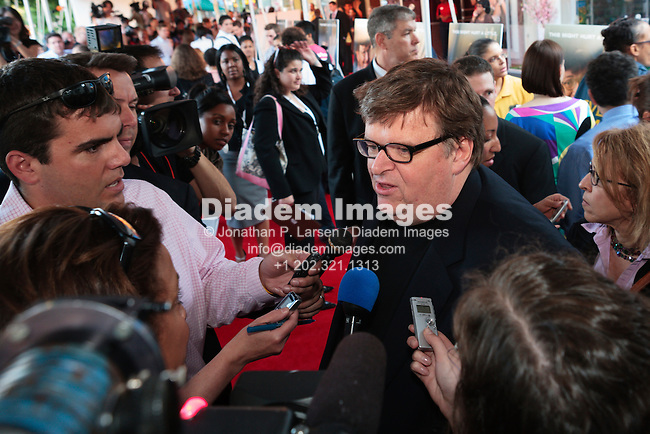 WASHINGTON, DC - JUNE 20:  Film director Michael Moore answers interview questions before the Washington, DC premiere of his film Sicko at the Uptown Theater on June 20, 2007 in Washington, DC.  (Photography by Jonathan Paul Larsen)