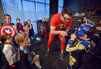 NWA Democrat-Gazette/BEN GOFF -- 05/29/15 Pastor Joe Liles interviews A.J. Wilcoxson, 8, about his costume during the costume contes on Popcorn Theology night at The Neighborhood Church in Bentonville on Friday May 29, 2015. Popcorn Theology programs feature a movie, this time the film was 'The Incredibles,' followed by a discussion of where religious themes could be seen in the movie.