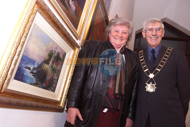 Mayor Jimmy Mulroy with Evelyn Reyburn and her painting 'The Lighthouse' at the Madame Le Worthy Amateur Art Competition in the Droichead Arts Centre..Picture: Paul Mohan/Newsfile