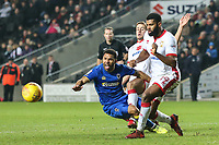 Andy Barcham of AFC Wimbledon is tackled by Scott Wootton of MK Dons and Ethan Ebanks-Landell of MK Dons during the Sky Bet League 1 match between MK Dons and AFC Wimbledon at stadium:mk, Milton Keynes, England on 13 January 2018. Photo by David Horn.