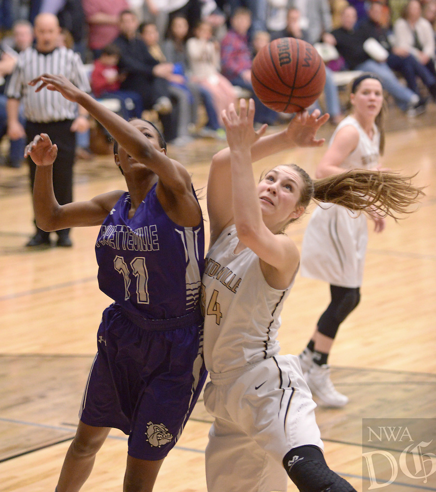 NWA Democrat-Gazette/BEN GOFF @NWABENGOFF<br /> Krista Clark (34) of Bentonville and Pink Jones of Fayetteville reach for a rebound on Friday Feb. 26, 2016 during the game in Bentonville's Tiger Arena.