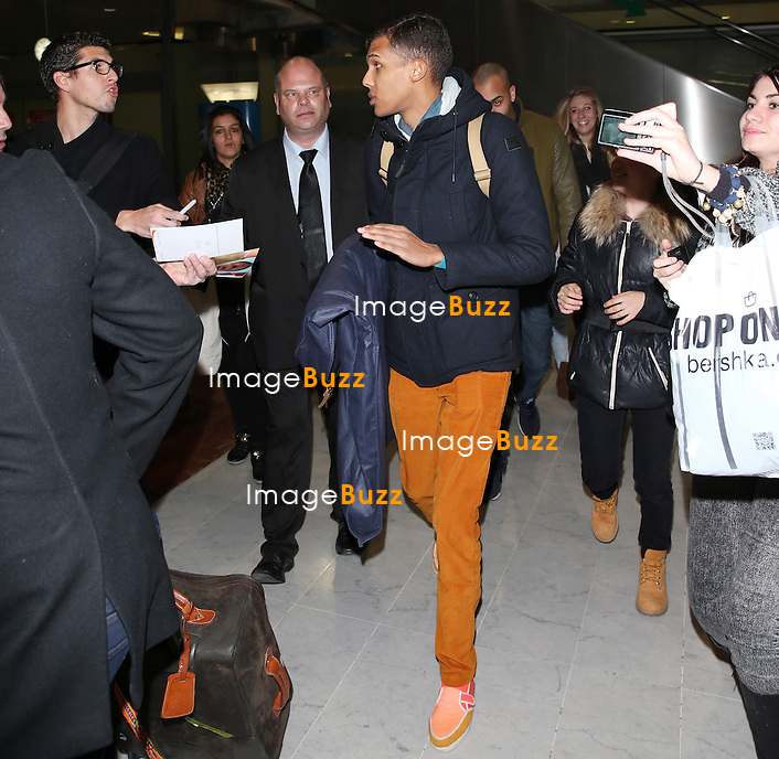 STROMAE arrives at Nice airport for the NRJ MUSIC AWARDS 2014.<br /> December 13, 2013.